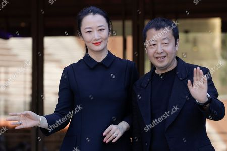 Actress Zhao Tao, left, and director Jia Zhangke pose during a photo call, at the Rome Film Fest, in Rome