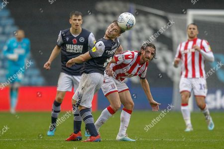 Millwall midfielder Ben Thompson (8) heads the ball forward during the EFL Sky Bet Championship match between Millwall and Stoke City at The Den, London