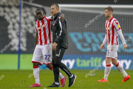 Millwall manager Gary Rowett with Stoke City midfielder Badou Ndiaye (27) after the EFL Sky Bet Championship match between Millwall and Stoke City at The Den, London