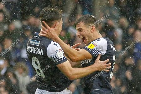 GOAL 1-0 Millwall midfielder Ben Thompson (8) scores and celebrates with Millwall midfielder Jayson Molumby (16) during the EFL Sky Bet Championship match between Millwall and Stoke City at The Den, London