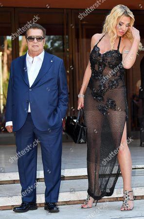 epa07951287 Italian producer Vittorio Cecchi Gori (L) and Italian actress Valeria Marini (R) arrive for the screening of 'Cecchi Gori-Una famiglia Italiana' at the 14th annual Rome Film Festival, in Rome, Italy, 26 October 2019. The film festival runs from 17 to 27 October.