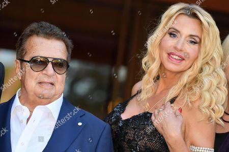 Italian producer Vittorio Cecchi Gori (L) and Italian actress Valeria Marini (R) arrive for the screening of 'Cecchi Gori-Una famiglia Italiana' at the 14th annual Rome Film Festival, in Rome, Italy, 26 October 2019. The film festival runs from 17 to 27 October.