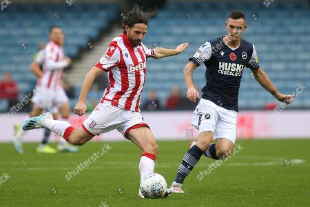 Joe Allen of Stoke City in action as Millwall's Shaun Williams looks on during Millwall vs Stoke City, Sky Bet EFL Championship Football at The Den on 26th October 2019