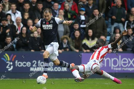 Jed Wallace of Millwall tries to elude a tackle from Stoke's Badou Ndiaye during Millwall vs Stoke City, Sky Bet EFL Championship Football at The Den on 26th October 2019