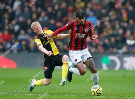 Philip Billing of Bournemouth is tackled by Will Hughes of Watford