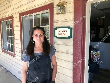 """Stock Picture of Owner Susan Slates, who is a Democrat, poses for picture outside her business """"Images Salon"""" in Agua Dulce, Calif. Slates says she's disappointed but is also sticking with Rep. Katie Hill, D-Calif., who was considered a rising Democratic star, but a looming congressional investigation has put her re-election at risk. In 2018, Hill captured the last Republican-held House seat anchored in Los Angeles County, part of a rout that saw Republicans driven out of a string of U.S. House seats in Southern California"""