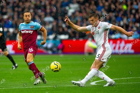 Mark Noble of West Ham United and Jack O'Connell of Sheffield United compete for the ball