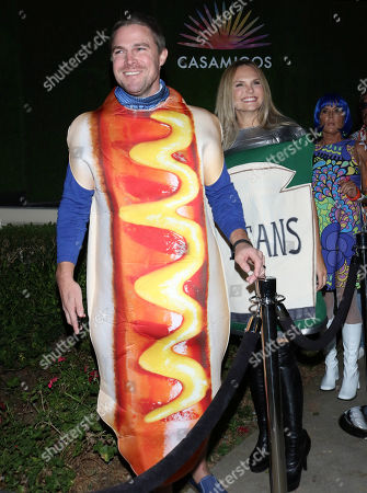 Stock Image of Stephen Amell and Cassandra Jean