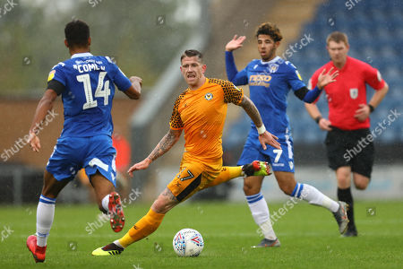 Scot Bennett of Newport County gets between Brandon Comley and Courtney Senior of Colchester United