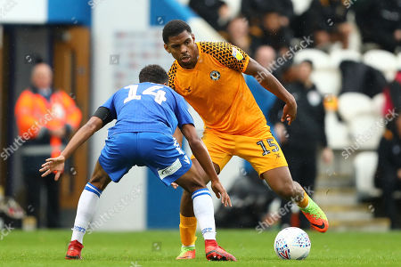Tristan Abrahams of Newport County looks to beat Brandon Comley of Colchester United