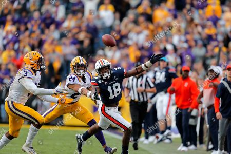 LSU cornerback Derek Stingley Jr. (24) and safety JaCoby Stevens (3) break top a pass intended for Auburn wide receiver Seth Williams (18) in the second half of an NCAA college football game in Baton Rouge, La., . LSU won 23-20