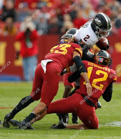 Stock Picture of Braxton Lewis, Greg Eisworth, Tylan Wallace. Iowa State defensive back Braxton Lewis, left, and Iowa State defensive back Greg Eisworth, right, tackle Oklahoma State wide receiver Tylan Wallace during the first half of an NCAA college football game, in Ames, Iowa