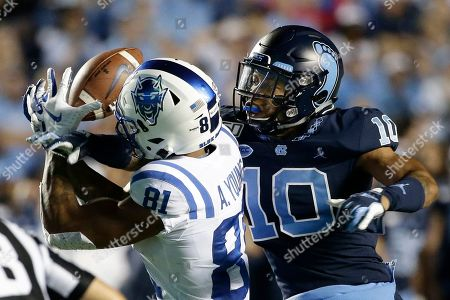 North Carolina defensive back Greg Ross (10) breaks up a pass intended for Duke wide receiver Aaron Young (81) during the second half of an NCAA college football game in Chapel Hill, N.C., . Ross was called for interference on the play