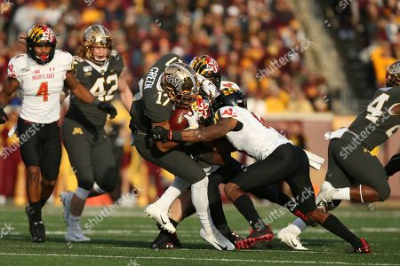 Minnesota wide receiver Seth Green (17) is tackled by Maryland defensive back Deon Jones (14) during an NCAA college football game, in Minneapolis