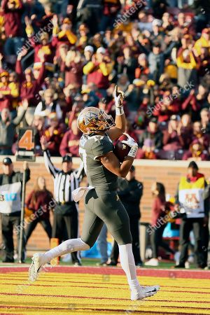 Minnesota wide receiver Seth Green (17) points skyward in the end zone after scoring a touchdown against Maryland during an NCAA college football game, in Minneapolis