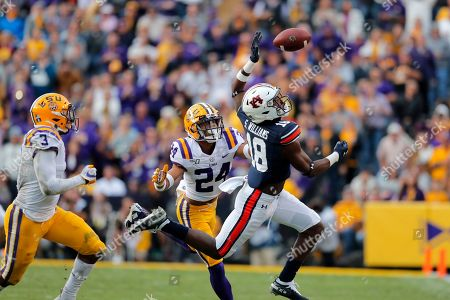 Auburn wide receiver Seth Williams (18) tries to pull in a pass in front of LSU cornerback Derek Stingley Jr. (24) and safety JaCoby Stevens (3) in the second half of an NCAA college football game in Baton Rouge, La., . LSU won 23-20