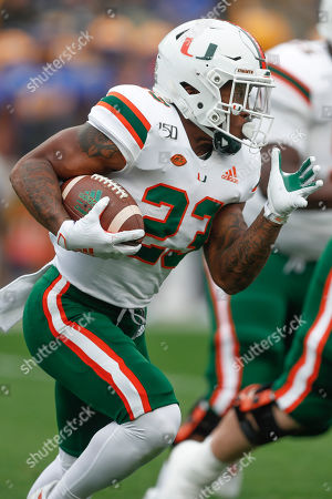 Miami running back Cam'Ron Harris (23) runs against Pittsburgh during the first half of an NCAA college football game, in Pittsburgh