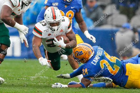 Miami running back Cam'Ron Harris (23) dives for more yardage past Pittsburgh linebacker Phil Campbell III (24) during the second half of an NCAA college football game, in Pittsburgh. Miami won 16-12