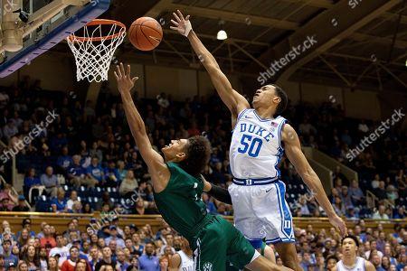 Duke's Justin Robinson (50) blocks the shot of Northwest Missouri State's Diego Bernard (1) during an NCAA college basketball exhibition game in Durham, N.C