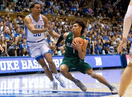 Northwest Missouri State's Diego Bernard (1) drives against Duke's Justin Robinson (50) during the first half of an NCAA college basketball exhibition game in Durham, N.C
