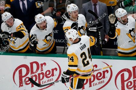 Stock Image of Jake Guentzel, Adam Johnson, Bryan Rust, Teddy Blueger, Dominik Kahun. Pittsburgh Penguins' Dominik Kahun (24) is congratulated by, from top left, Jake Guentzel (59), Zach Aston-Reese (46), Teddy Blueger (53) and Bryan Rust after scoring against the Dallas Stars in the third period of an NHL hockey game in Dallas
