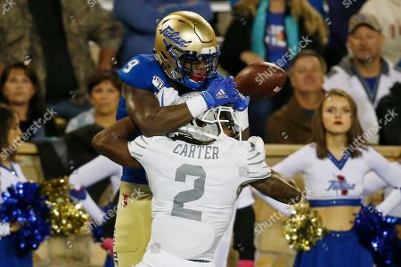 Memphis defensive back T.J. Carter (2) breaks up a pass intended for Tulsa wide receiver Sam Crawford Jr. (9) in the first half of an NCAA college football game in Tulsa, Okla