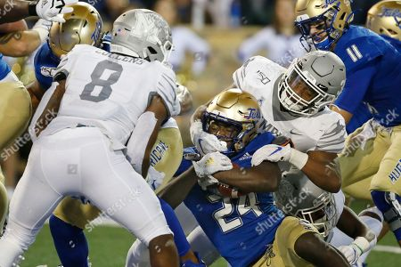 Corey Taylor II, Xavier Cullens, Tim Hart. Tulsa running back Corey Taylor II (24) fights his way past Memphis defenders Xavier Cullens (8) and Tim Hart, right, into the end zone to score in the first half of an NCAA college football game in Tulsa, Okla