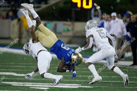 Sam Crawford Jr., T.J. Carter, Quindell Johnson. Tulsa wide receiver Sam Crawford Jr. (9) is upended by Memphis defensive back T.J. Carter, left, in the second half of an NCAA college football game in Tulsa, Okla., . Memphis defensive back Quindell Johnson is at right