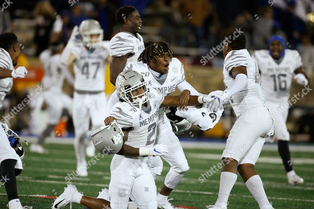 T.J. Carter, Cameron Fleming, Kendell Johnson. Memphis players T.J. Carter (2), Cameron Fleming, center, and Kendell Johnson, right, celebrate at the end of the game after defeating Tulsa 42-41 in an NCAA college football game in Tulsa, Okla