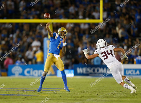 UCLA Bruins quarterback Dorian Thompson-Robinson #1 throws a pass during the NCAA Football game between the Arizona State Sun Devils and the UCLA Bruins at the Rose Bowl in Pasadena, California. Mandatory Photo Credit : Charles Baus/CSM