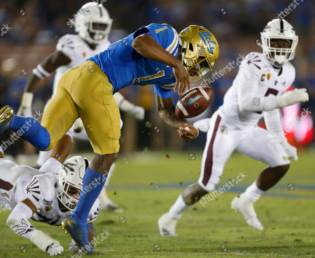 UCLA Bruins quarterback Dorian Thompson-Robinson #1 fumbles the ball during the NCAA Football game between the Arizona State Sun Devils and the UCLA Bruins at the Rose Bowl in Pasadena, California. Mandatory Photo Credit : Charles Baus/CSM
