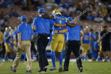 UCLA Bruins quarterback Dorian Thompson-Robinson #1 is helped off the field after getting injured during the NCAA Football game between the Arizona State Sun Devils and the UCLA Bruins at the Rose Bowl in Pasadena, California. Mandatory Photo Credit : Charles Baus/CSM