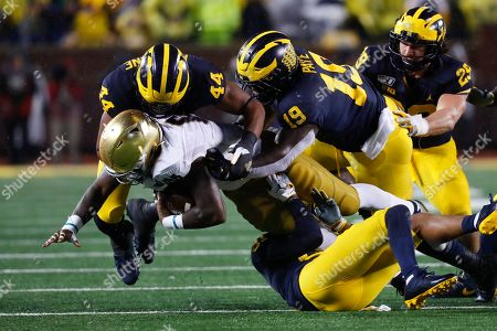 Notre Dame running back Jafar Armstrong (8) is brought down by Michigan linebacker Cameron McGrone (44), defensive lineman Kwity Paye (19) and defensive back Vincent Gray in the first half of an NCAA college football game in Ann Arbor, Mich