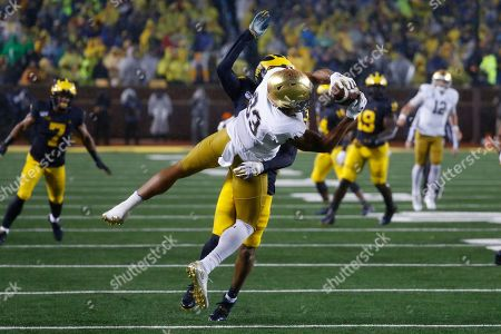 Notre Dame wide receiver Chase Claypool (83) catches a pass as Michigan defensive back Vincent Gray (31) defends in the first half of an NCAA college football game in Ann Arbor, Mich