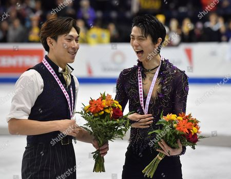 Winner Japan's Yuzuru Hanyu (R) and 3rd placed Japan's Keiji Tanaka celebrate during the ISU Grand Prix of Figure Skating 2019 Skate Canada International Men's Single Award Ceremony