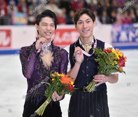 Winner Japan's Yuzuru Hanyu (L) and 3rd placed Japan's Keiji Tanaka celebrate during the ISU Grand Prix of Figure Skating 2019 Skate Canada International Men's Single Award Ceremony
