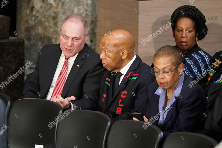 United States House Minority Whip Steve Scalise (Republican of Louisiana) talks with US Representative John Lewis (Democrat of Georgia) as they gather with Delegate Eleanor Holmes Norton (Democrat of the District of Columbia) and US Representative Sheila Jackson Lee (Democrat of Texas) prior to a ceremony in honor of US Representative Elijah Cummings (Democrat of Maryland), who died on October 17 and who will lie in state in Statuary Hall at the U.S. Capitol in Washington, DC.