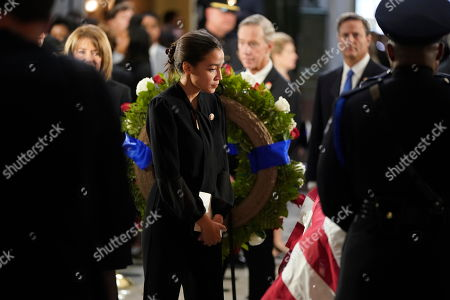 United States Representative Alexandria Ocasio-Cortez (Democrat of New York) visits the flag-draped casket of US Representative Elijah Cummings (Democrat of Maryland) after a memorial service in Statuary Hall of the U.S. Capitol on Capitol Hill in Washington, DC,.