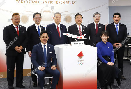 (Front L-R) Judo Olympic gold medalist Tadahiro Nomura and women's wrestling Olympic gold medalist Saori Yoshida (Back L-R) comedy duo Sandwitchman member Mikio Date, All Nippon Airways (ANA) president Yuji Hirako, Tokyo 2020 Olympics committee president Yoshiro Mori, former Olympic Minister Toshiaki Endo, Japan Airlines (JAL) president Yuji Akasaka and Sandwitchman member Takeshi Tomizawa pose for photo as they display the aircraft design to deliver Olympic flame from Greece in Tokyo