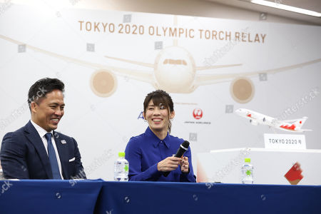 Judo Olympic gold medalist Tadahiro Nomura and women's wrestling Olympic gold medalist Saori Yoshida display the aircraft design to deliver Olympic flame from Greece in Tokyo