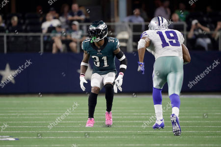 Philadelphia Eagles cornerback Jalen Mills (31) defends as Dallas Cowboys wide receiver Amari Cooper (19) runs a route during the first half of an NFL football game in Arlington, Texas