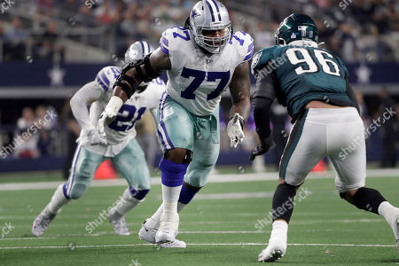 Dallas Cowboys offensive tackle Tyron Smith (77) faces off against Philadelphia Eagles defensive end Derek Barnett (96) during the first half of an NFL football game against the in Arlington, Texas