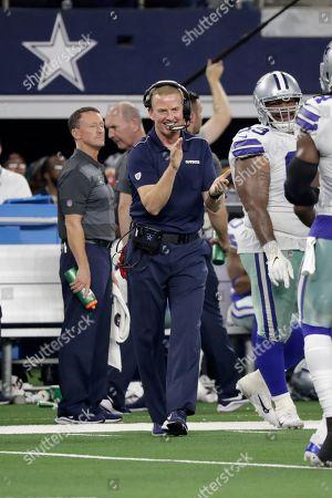 Dallas Cowboys head coach Jason Garrett reacts as his defense walks off the field during the first half of an NFL football game against the Philadelphia Eagles in Arlington, Texas