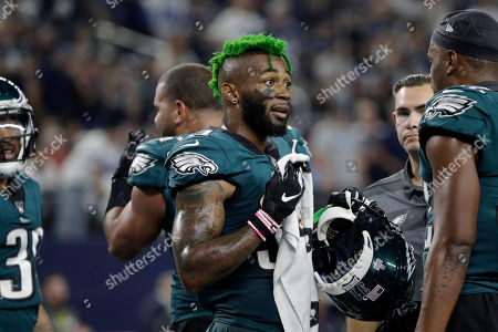 Philadelphia Eagles cornerback Jalen Mills talks with teammates during the first half of an NFL football game against the Dallas Cowboys in Arlington, Texas