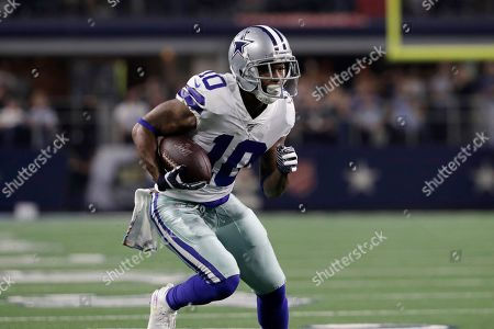 Dallas Cowboys wide receiver Tavon Austin advances the ball after a catch during the first half of an NFL football game against the Philadelphia Eagles in Arlington, Texas