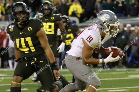 Washington State's Brandon Arconado, right, pulls down a touchdown pass ahead of Oregon's Isaac Slade-Matautia, left, during the fourth quarter of an NCAA college football game, in Eugene, Ore