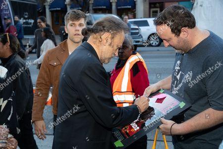 Franco Nero autographs a fan's poster