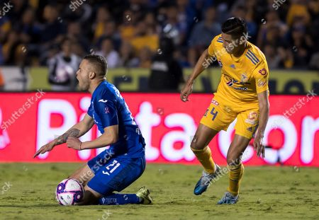 Hugo Ayala (R) of Tigres UANL in action against Jonathan Rodriguez (L) of Cruz Azul during the Apertura Tournament soccer match between Tigres UANL and Cruz Azul at the Universitario Stadium, in Monterrey, Mexico, 26 October 2019.