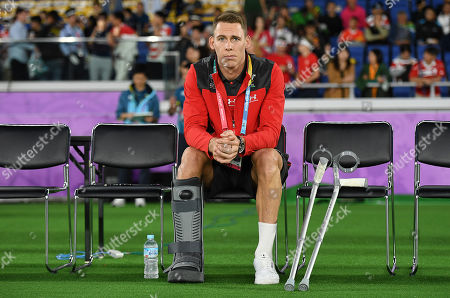 Stock Image of Liam Williams of Wales sits on the bench injured.