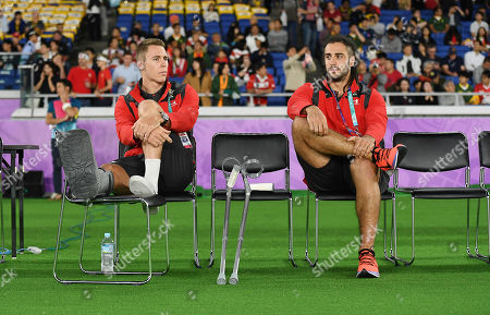 Stock Picture of Liam Williams and Josh Navidi sit on the bench injured.